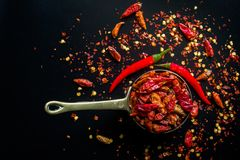 Red hot Chilli Chillies pepper on black Stock Image