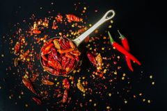 Red hot Chilli Chillies pepper on black Royalty Free Stock Image