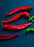 Red hot chilli pepper on a background of bright hot hot Stock Image