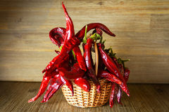 Red hot chilli pepper in the basket on wooden table background Stock Images