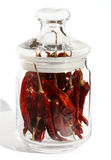 Red hot chilli pepper in glass Stock Photo