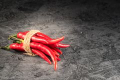 Red hot chilli pepper paprika in and peppers seed ball on stone table. Ingredient for Mexican cooking Trendy toned image in minimal rustic style royalty free stock image