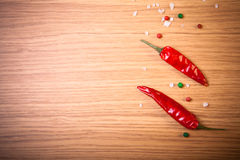 Red hot chilli pepper with sea salt and colored pepper on wooden Royalty Free Stock Image