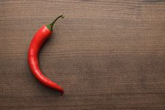 Red hot chilli pepper on wooden table Royalty Free Stock Image