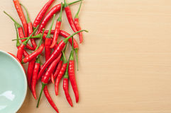Red hot chilli peppers. Red hot chili peppers on the wooden desk with copy space Royalty Free Stock Photo