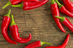 Red hot chilli peppers frame Stock Photos