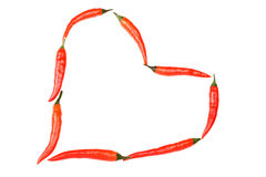 Red hot chilli peppers in heart shape Royalty Free Stock Images