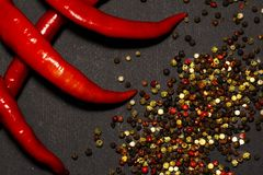 Red hot chilli peppers and pods on a dark background. View from above. Red pepper Stock Images