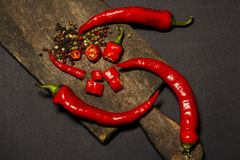 Red hot chilli peppers and pods on a dark background. View from above. Red pepper Stock Photos