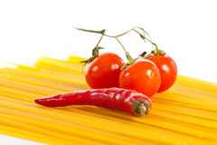 Red Hot Chilli Peppers, Tomatoes And Pasta Royalty Free Stock Photo