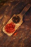 Red hot chillies and chipotle. Jalapeno smoked chili flakes on textured woden background Stock Photo