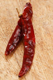Red hot chillies pepper on old wood royalty free stock photography