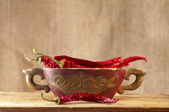 Red hot chillies pepper in old wooden bowl Royalty Free Stock Images