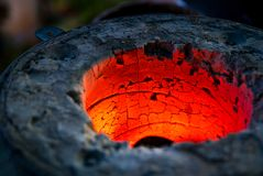 Red Hot. A closeup picture of a red hot oven for melting metals Royalty Free Stock Image