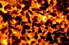 Bright orange light from the hot coal anthracite fines. Red hot coal as background stock images