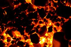 Bright orange light from the hot coal anthracite of small and coarse fraction. Red hot coal as background stock image