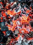 Red-hot coal. Red hot burning coals background royalty free stock photo