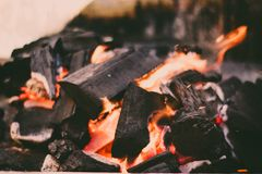 Red hot coal for cooking. A big bonfire to prepare delicious food on a beautiful afternoon stock photo