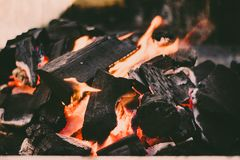 Red hot coal for cooking. A big bonfire to prepare delicious food on a beautiful afternoon royalty free stock photo