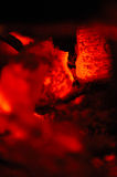 Red hot coals. Macro view of burning red hot coals Royalty Free Stock Images