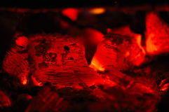 Red hot coals in fireplace royalty free stock images
