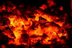 Red-hot coals. Glittering lights in the coals stock photography