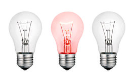 Red Hot Concept Idea - White and Red Lightbulb Stock Photo
