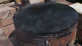 The red-hot cooking stove Turkish close up. Turkish national food cooking prosessing stock video footage