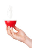 Red hot cup of coffee in hand Royalty Free Stock Photo