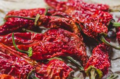 Red hot dried peppers on a crafting paper stock images
