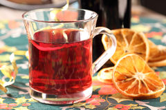 Red hot drink and orange sliced Stock Photos