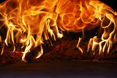 Red hot flames from wood in fireplace stock photo