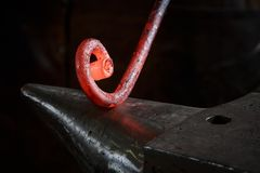 Red-hot glands in the work of a blacksmith royalty free stock photo