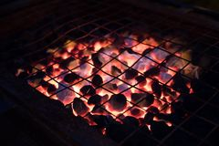 Red hot grill outdoor with charcoal ready for BBQ at night. Red hot grill with charcoal ready for BBQ meats at night time Stock Photo