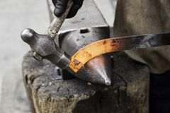 Red hot iron in a forge. Working with hot iron, traditional work stock photo