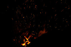 Red hot lines sparks on a black background Royalty Free Stock Images