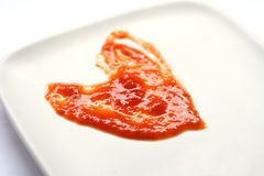 Red Hot Love Served. This heart shape was formed from Chilli sauce served on a plate. Add new meaning to HOT SPICY love Royalty Free Stock Photos