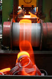 Red-hot metal. Preparations for bearing with red-hot metal falling from the moving conveyor Stock Photo