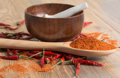 Red hot pepper chili powder in a mortar and pods Stock Photo
