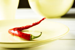 Red hot pepper on green dish. Stock Photography