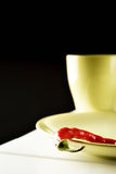 Red hot pepper on green dish. Royalty Free Stock Photo