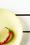 Red hot pepper on green dish. Stock Photo