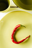 Red hot pepper on green dish. Stock Images