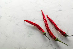 Red hot pepper pod dry. Bright stone background. Stock Photo