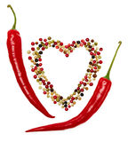 Peppers red hot in pods and mixture of peppercorns.Love concept  Stock Photography