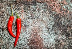 Red hot pepper. On rustic background royalty free stock photography
