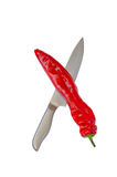 Red hot pepper and sharp knife Stock Photos