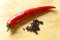 Red hot pepper shiny on board Royalty Free Stock Images
