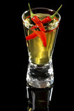 Red Hot Pepper Vodka or Tequila Shooter. Red hot chilli pepper vodka or tequila shooter glass on black background Royalty Free Stock Photos