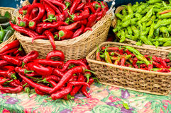 Red hot peppers in baskets Royalty Free Stock Photos